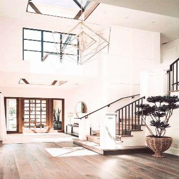 Beautiful light filled home with high ceilings, large windows, statement chandelier