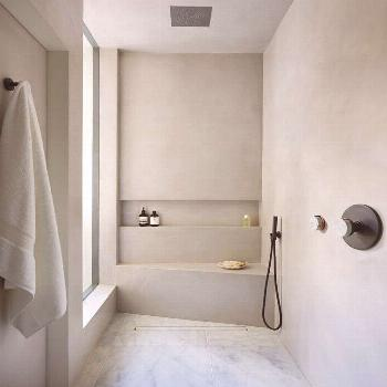 RT Interiors's luxurious wet room using tadelakt, marble flooring and The Watermark Collection's El