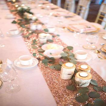 Sparkly table runner with wood candle holders