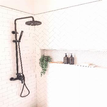 Use subway tile but mix up the installation patter for a unique look in your shower.