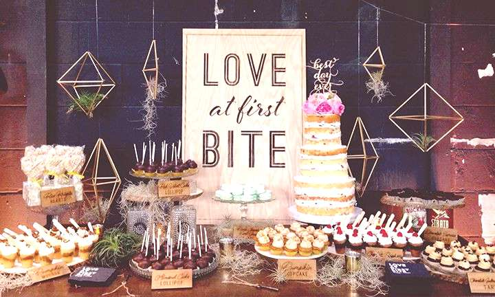 Cool sign, air plants and suspended decor and look at those  sweets! ~ we ❤ this!