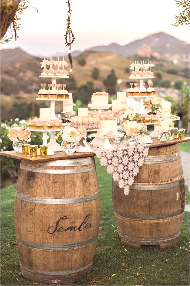 Create a rustic feel for your dessert table using old wooden wine barrels and a vintage lace doily