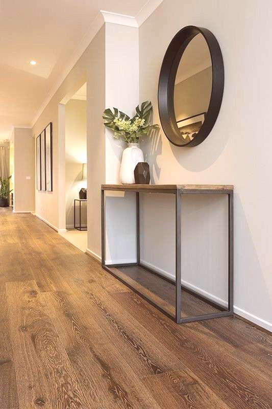 Keeping bare walls decorated without the clutter in this foyer space.
