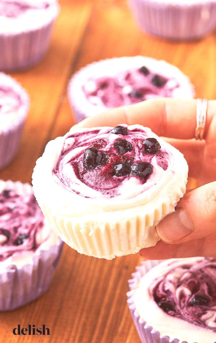 Lemon Blueberry Mini Cheesecakes These sweet treats are perfect for spring. Get the recipe at .