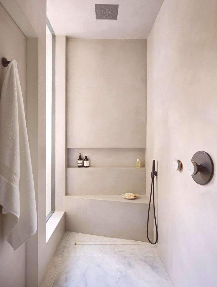 RT Interiorss luxurious wet room using tadelakt, marble flooring and The Watermark Collections El